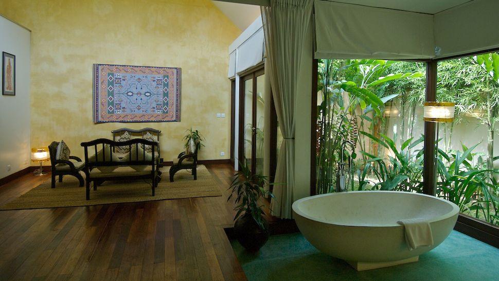 Heritage suites hotel suites con salas de vapor y for Cuadros cuarto de bano originales